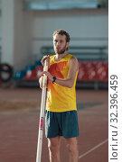 Купить «Pole vaulting - man with a beard in yellow shirt is standing with a pole», фото № 32396459, снято 1 ноября 2019 г. (c) Константин Шишкин / Фотобанк Лори