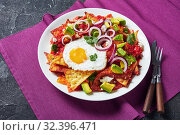 Купить «nachos with a fried egg and tomato sauce», фото № 32396471, снято 13 сентября 2019 г. (c) Oksana Zh / Фотобанк Лори