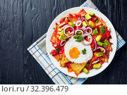Купить «close-up of spicy chilaquiles on a plate», фото № 32396479, снято 13 сентября 2019 г. (c) Oksana Zh / Фотобанк Лори