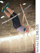 Купить «Pole vaulting - young woman in purple shirt is falling after jump», фото № 32396535, снято 1 ноября 2019 г. (c) Константин Шишкин / Фотобанк Лори