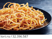 Купить «close-up of french crispy fried onion rings», фото № 32396587, снято 18 сентября 2019 г. (c) Oksana Zh / Фотобанк Лори