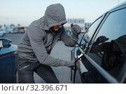 Car thief breaking door lock, criminal job. Стоковое фото, фотограф Tryapitsyn Sergiy / Фотобанк Лори