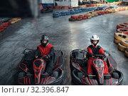 Two kart racers on start line, karting auto sport. Стоковое фото, фотограф Tryapitsyn Sergiy / Фотобанк Лори