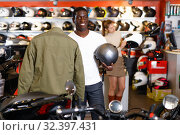 Купить «Portrait of young Afro man satisfied with new riding gear at motorcycle shop», фото № 32397431, снято 16 января 2019 г. (c) Яков Филимонов / Фотобанк Лори