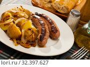 Купить «Roasted sausages with potatoes», фото № 32397627, снято 16 ноября 2019 г. (c) Яков Филимонов / Фотобанк Лори