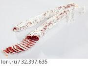 Fuet sausage with cut slices. Стоковое фото, фотограф Яков Филимонов / Фотобанк Лори