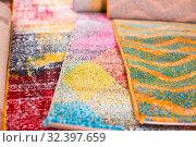 Купить «Image of colorful wool carpets for sale at showroom», фото № 32397659, снято 22 ноября 2017 г. (c) Яков Филимонов / Фотобанк Лори