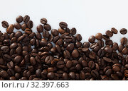 Coffee beans on white surface. Стоковое фото, фотограф Яков Филимонов / Фотобанк Лори