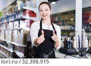 Купить «Professional positive female hairdresser holding thumbs up in salon», фото № 32398915, снято 31 марта 2018 г. (c) Яков Филимонов / Фотобанк Лори