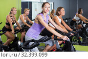 Women cycling in fitness center. Стоковое фото, фотограф Яков Филимонов / Фотобанк Лори