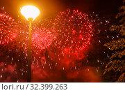 Купить «Defocused red firework lighting and yellow lantern against black night sky. Abstract background», фото № 32399263, снято 18 августа 2019 г. (c) Наталья Николаева / Фотобанк Лори