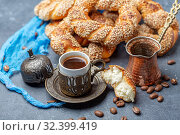 Turkish black coffee served in traditional ceramic cup with sesame bagel, selective focus. Стоковое фото, фотограф Марина Сапрунова / Фотобанк Лори