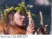 Expression young woman in clothing aborigine of Kamchatka Peninsula. Редакционное фото, фотограф А. А. Пирагис / Фотобанк Лори
