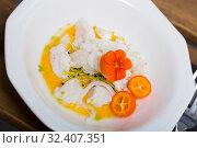 Купить «Ceviche from horse-mackerelon plate with cumquat, greens and spicy avocado sauce», фото № 32407351, снято 28 января 2020 г. (c) Яков Филимонов / Фотобанк Лори