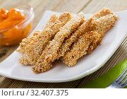 Купить «Sesame crusted chicken fingers with sauce», фото № 32407375, снято 8 апреля 2020 г. (c) Яков Филимонов / Фотобанк Лори