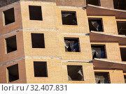 Купить «Brick wall facade with empty apertures for windows, building under construction», фото № 32407831, снято 16 декабря 2012 г. (c) Кекяляйнен Андрей / Фотобанк Лори