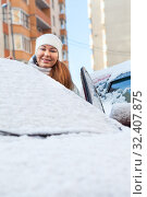 Купить «Smiling woman a driver opening door of car, windshield covered with snow, winter season», фото № 32407875, снято 19 января 2014 г. (c) Кекяляйнен Андрей / Фотобанк Лори