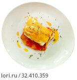 Купить «Closeup of codfish backed with sauces and served, nobody», фото № 32410359, снято 5 декабря 2019 г. (c) Яков Филимонов / Фотобанк Лори