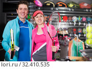 Купить «couple is demonstraiting racket for tennis», фото № 32410535, снято 7 февраля 2018 г. (c) Яков Филимонов / Фотобанк Лори