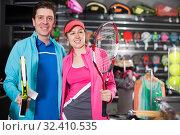 couple is demonstraiting racket for tennis. Стоковое фото, фотограф Яков Филимонов / Фотобанк Лори