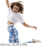 Купить «Young sexy dancer jumping gracefully in studio», фото № 32411355, снято 24 ноября 2016 г. (c) Гурьянов Андрей / Фотобанк Лори