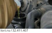 Pouring oil to car engine. Стоковое видео, видеограф Vasily Alexandrovich Gronskiy / Фотобанк Лори