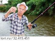Купить «Fisherman changing bait on hook», фото № 32415451, снято 10 июня 2018 г. (c) Яков Филимонов / Фотобанк Лори