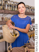 Купить «adult woman customer with shopping bag in biofood store», фото № 32415859, снято 13 июня 2017 г. (c) Яков Филимонов / Фотобанк Лори