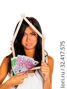 Купить «Eine junge Frau möchte ein Haus bauen», фото № 32417575, снято 21 ноября 2019 г. (c) age Fotostock / Фотобанк Лори