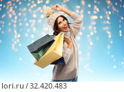 Купить «young woman in winter hat with shopping bags», фото № 32420483, снято 30 сентября 2019 г. (c) Syda Productions / Фотобанк Лори