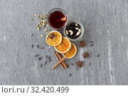 Купить «hot mulled wine, orange slices, raisins and spices», фото № 32420499, снято 4 октября 2018 г. (c) Syda Productions / Фотобанк Лори