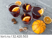 Купить «glasses of mulled wine with orange and cinnamon», фото № 32420503, снято 4 октября 2018 г. (c) Syda Productions / Фотобанк Лори