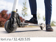 young businessman with electric scooter outdoors. Стоковое фото, фотограф Syda Productions / Фотобанк Лори