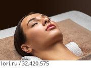 Купить «young woman lying at spa or massage parlor», фото № 32420575, снято 13 октября 2019 г. (c) Syda Productions / Фотобанк Лори