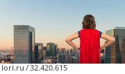 Купить «woman in red superhero cape over tokyo city», фото № 32420615, снято 30 сентября 2019 г. (c) Syda Productions / Фотобанк Лори