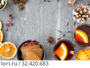 Купить «hot mulled wine, orange slices, raisins and spices», фото № 32420683, снято 4 октября 2018 г. (c) Syda Productions / Фотобанк Лори