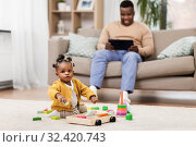 Купить «african baby girl playing with toy blocks at home», фото № 32420743, снято 29 сентября 2019 г. (c) Syda Productions / Фотобанк Лори