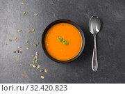 Купить «vegetable pumpkin cream soup in bowl with spoon», фото № 32420823, снято 5 апреля 2018 г. (c) Syda Productions / Фотобанк Лори
