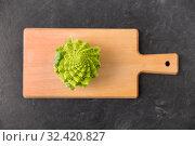romanesco broccoli on wooden cutting board. Стоковое фото, фотограф Syda Productions / Фотобанк Лори