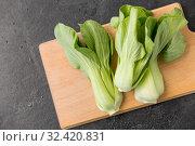 Купить «bok choy chinese cabbage on wooden cutting board», фото № 32420831, снято 12 апреля 2018 г. (c) Syda Productions / Фотобанк Лори