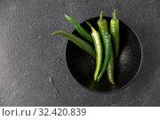 Купить «close up of green chili peppers in bowl», фото № 32420839, снято 12 апреля 2018 г. (c) Syda Productions / Фотобанк Лори