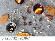 Купить «hot mulled wine, orange slices, raisins and spices», фото № 32420867, снято 4 октября 2018 г. (c) Syda Productions / Фотобанк Лори