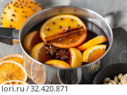 Купить «pot with hot mulled wine, orange slices and spices», фото № 32420871, снято 4 октября 2018 г. (c) Syda Productions / Фотобанк Лори