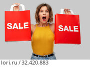 Купить «surprised young woman with shopping bags on sale», фото № 32420883, снято 30 сентября 2019 г. (c) Syda Productions / Фотобанк Лори
