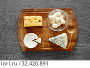 Купить «different kinds of cheese on wooden cutting board», фото № 32420891, снято 16 августа 2018 г. (c) Syda Productions / Фотобанк Лори