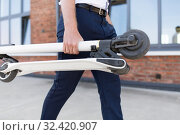 Купить «businessman with folding scooter on rooftop», фото № 32420907, снято 1 августа 2019 г. (c) Syda Productions / Фотобанк Лори