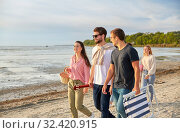 Купить «happy friends walking along summer beach», фото № 32420915, снято 31 августа 2019 г. (c) Syda Productions / Фотобанк Лори