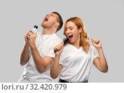 Купить «happy couple singing to hairbrush and lotion», фото № 32420979, снято 6 октября 2019 г. (c) Syda Productions / Фотобанк Лори