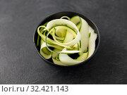 Купить «peeled or sliced zucchini in ceramic bowl», фото № 32421143, снято 12 апреля 2018 г. (c) Syda Productions / Фотобанк Лори