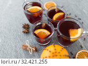 Купить «glasses of mulled wine with orange and cinnamon», фото № 32421255, снято 4 октября 2018 г. (c) Syda Productions / Фотобанк Лори